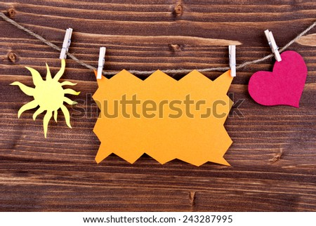 Orange Tag Or Label With Sun And Heart On A Line With Copy Space Or Your Free Text Here On Wooden Background, Two Symbols, Vintage, Retro And Old Fashion Style - stock photo