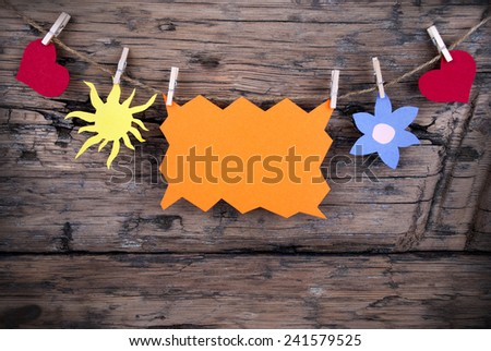 Orange Tag Or Label With Sun And Two Hearts And Flower On A Line With Copy Space Or Your Free Text Here On Wooden Background, Four Symbols, Vintage, Retro And Old Fashion Style With Frame - stock photo