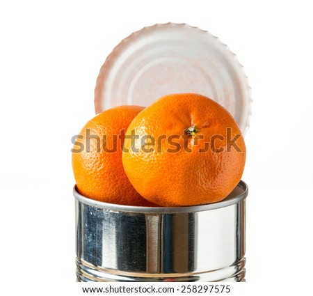 Orange, tangerine or satsuma fruit heaped inside opened tin can container in concept of fresh food coming in cans - stock photo
