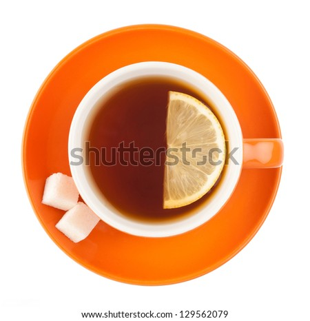 Orange teacup with sugar and lemon isolated on white background. - stock photo
