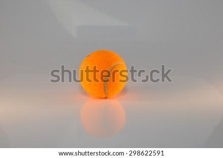 orange tennis ball - stock photo