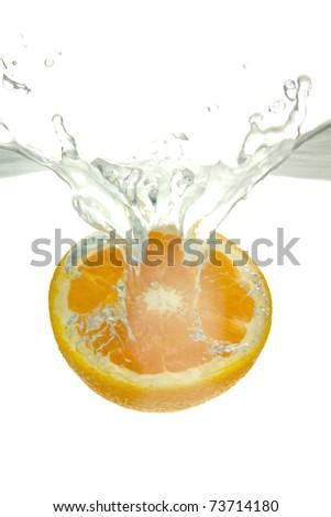 Orange thrown into the water with splash, on white background. - stock photo