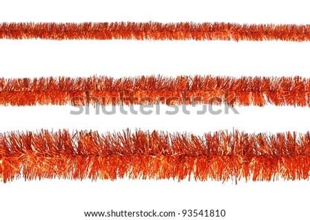 Orange tinsel isolated on a white background - stock photo