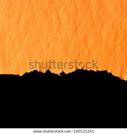 orange torn paper. - stock photo