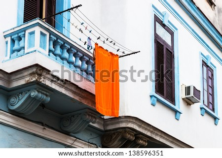 orange towel hanging on the balcony - stock photo