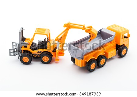 Orange tractor toy construction on white background