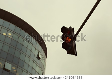Orange traffic light in the city, Traffic lights against sky backgrounds, vintage color filter - stock photo