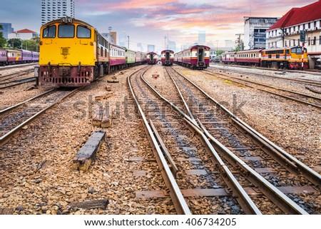 orange train diesel locomotive on bangkok railway station , thailand - stock photo