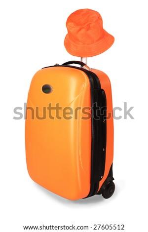 Orange travel case and sun hat from sun - stock photo