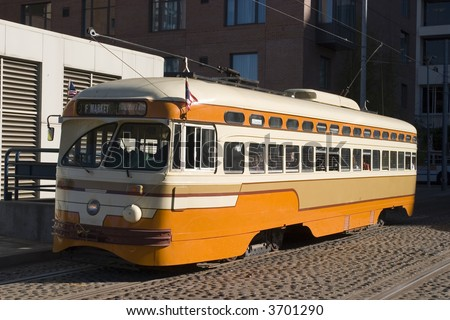 orange Trolley Old car Public transportation in San Francisco California - stock photo