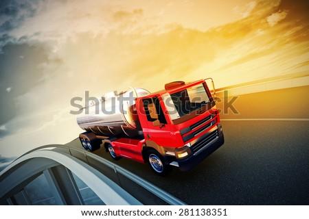 Orange truck on asphalt road highway at sunset - transportation background  - stock photo