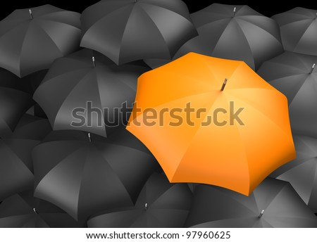 Orange umbrella standing out from background of black umbrellas - stock photo