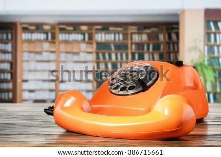 Orange vintage phone - stock photo