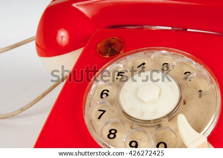 Orange vintage telephone taking a call, ideal for contact page
