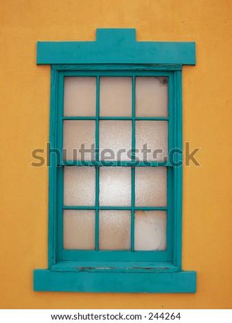 orange wall, teal window - stock photo