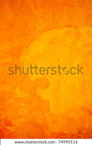 Orange wall with cracks and peeling paint. - stock photo