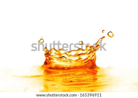orange water splash isolated on white - stock photo