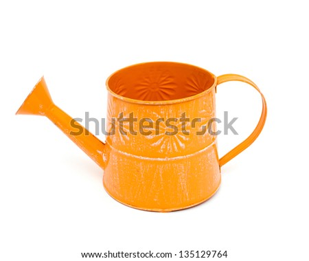 orange watering can isolated on white background