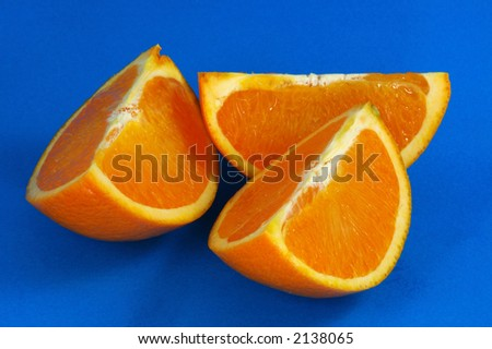 Orange Wedges Over Blue Background - stock photo