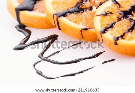 orange wire wheels with molten chocolate - stock photo