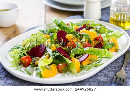Orange with Beetroot and pumpkin seed salad by balsamic dressing - stock photo