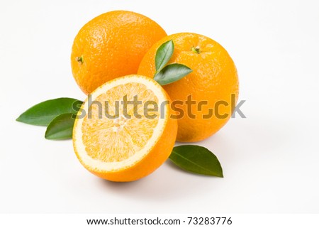 orange with leaves with clipping path - stock photo