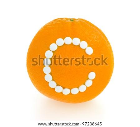 Orange with vitamin c pills over white background - concept - stock photo
