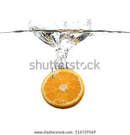 orange with water splash on white - stock photo