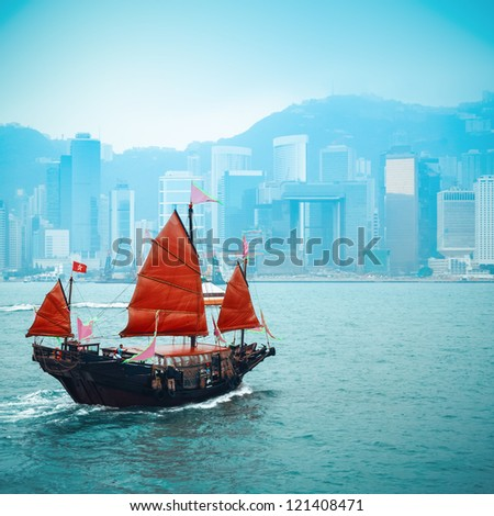 orange wooden sailboat sailing in victoria harbor at Hong Kong - stock photo