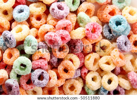Orange, yellow, blue, and green fruit cereal - stock photo