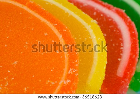 Orange, yellow, red and green sugar citrus candy