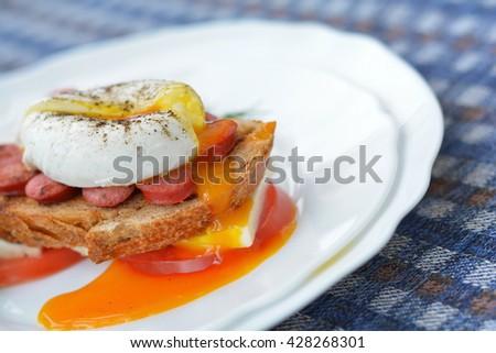 Orange yolk of poached egg - stock photo
