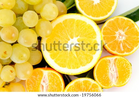 oranges and grapes against white background