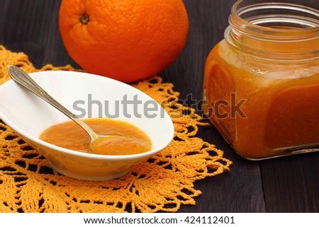 oranges and orange jam - stock photo
