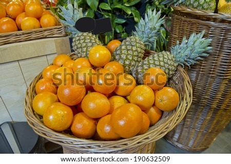oranges and pineapples on the market - stock photo