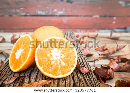 Oranges cut set on old wooden background. - stock photo