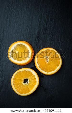 Oranges fruit cutting - stock photo