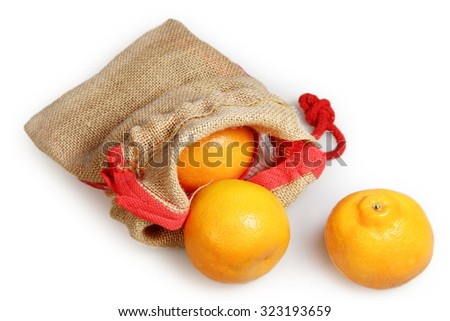 Oranges in a bag from a canvas on a white background - stock photo