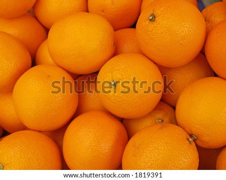 Oranges in a market, close-up - stock photo
