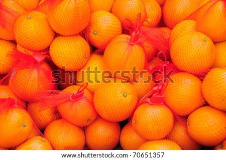 Oranges in net bag - stock photo