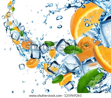 Oranges in water splash with ice cubes - stock photo