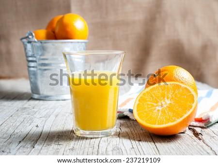 Oranges isolated cut set on wooden base - stock photo