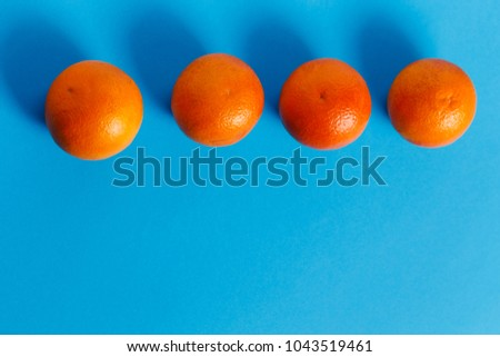 Oranges Isolated On Blue Background Complementary Colors