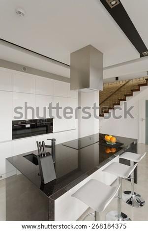 Oranges on granite worktop in modern kitchen - stock photo