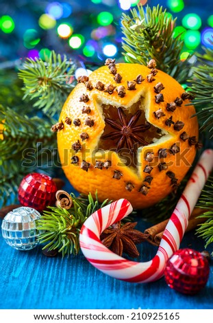 Oranges pierced with cloves,Christmas spices and nuts - stock photo