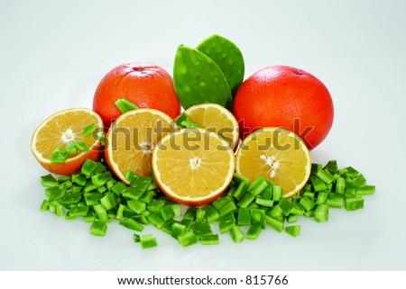 Oranges with chopped cactus - stock photo