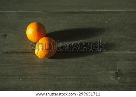oranges with long sunset shades on garden table