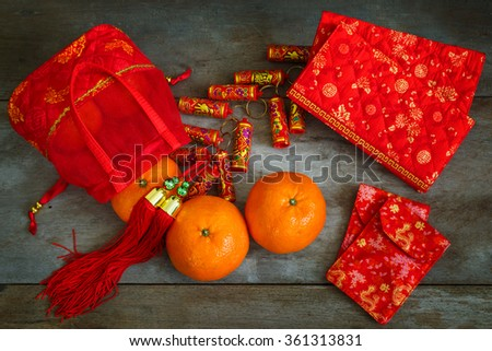 Oranges with Red Lucky Pouches and Firecracker Prepared for a Chinese New Year