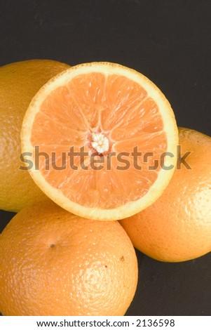 Oranges with sliced half - stock photo
