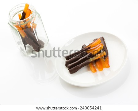 Orangette - candied orange zest coated in dark chocolate. Part of French cuisine.  - stock photo
